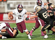 Jordan quarterback Jordan Kafentzis (2) stiff arms Lone Peak's Spencer Reinstein (55) during the Utah State High School 5A Football semifinal between in Rice-Eccles Stadium, Thursday, Nov. 8, 2012.