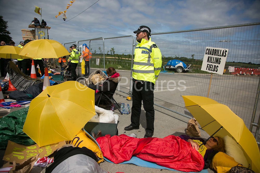 12 local activists locked themselves in specially made arm tubes to block the entrance to Quadrillas drill site in New Preston Road, July 03 2017, Lancashire, United Kingdom. Activists, protectors and supports. The 13 activists included 3 councillors; Julie Brickles, Miranda Cox and Gina Dowding and Nick Danby, Martin Porter, Jeanette Porter,  Michelle Martin, Louise Robinson,<br /> Alana McCullough, Nick Sheldrick, Cath Robinson, Barbara Cookson, Dan Huxley-Blyth. The blockade is a repsonse to the emmidiate drilling for shale gas, fracking, by the fracking company Quadrilla. Lancashire voted against permitting fracking but was over ruled by the conservative central Government. All the activists have been active in the struggle against fracking for years but this is their first direct action of peacefull protesting. Fracking is a highly contested way of extracting gas, it is risky to extract and damaging to the environment and is banned in parts of Europe . Lancashire has in the past experienced earth quakes blamed on fracking.