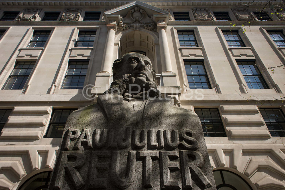"""A stone carving of the German-born news tycoon, Paul Julius Reuter, seen at lunchtime in the City of London, the capital's financial district. Paul Julius Freiherr von Reuter (Baron de Reuter) (21 July 1816 – 25 February 1899), a German entrepreneur, pioneer of telegraphy and news reporting was a journalist and media owner, and the founder of the Reuters news agency. Reuter founded Reuters, one of the major financial news agencies of the world. On 17 March 1857, Reuter was naturalised as a British subject, and on 7 September 1871, the German Duke of Saxe-Coburg-Gotha conferred a barony (Freiherr) on Julius Reuter. The title was later """"confirmed by Queen Victoria as conferring the privileges of the nobility in England"""""""