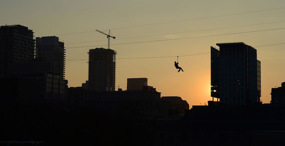 A zip liner flies high above Nathan Phillips Square during Grey Cup festivities in Toronto on Thursday, November 22, 2012. Calgary Stampeders will play the Toronto Argonauts in the Canadian Football League Grey Cup Sunday, Nov. 25, 2012. THE CANADIAN PRESS/Sean Kilpatrick