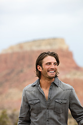All American man outdoors with a big smile