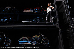 Joey Courtney worked the Indian Motorcycles display on Main Street during Daytona Bike Week. Daytona Beach, FL. USA. Friday March 16, 2018. Photography ©2018 Michael Lichter.