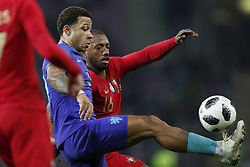 (L-R) Memphis Depay of Holland, Manuel Fernandes of Portugal during the International friendly match match between Portugal and The Netherlands at Stade de Genève on March 26, 2018 in Geneva, Switzerland