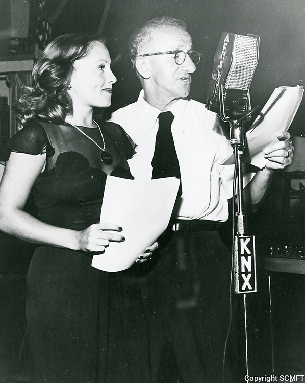1944 Diane Lewis and Jimmy Durante during a radio broadcast from the Hollywood Canteen