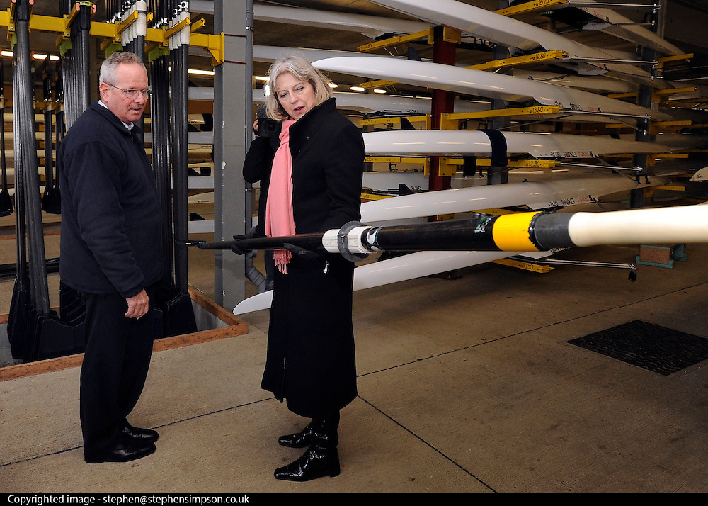 © Licensed to London News Pictures. 27/02/2012, Windsor, UK. (L-R ) IVOR LLOYD Managing Director of Dorney Lake shows Home Secretary Theresa May how light a professional oar is during her visit to Eton College Rowing Centre in Windsor today 27 february 2012 to see the preparations being made ahead of the London Olympic and Paralympic Games. Photo credit : Stephen Simpson/LNP
