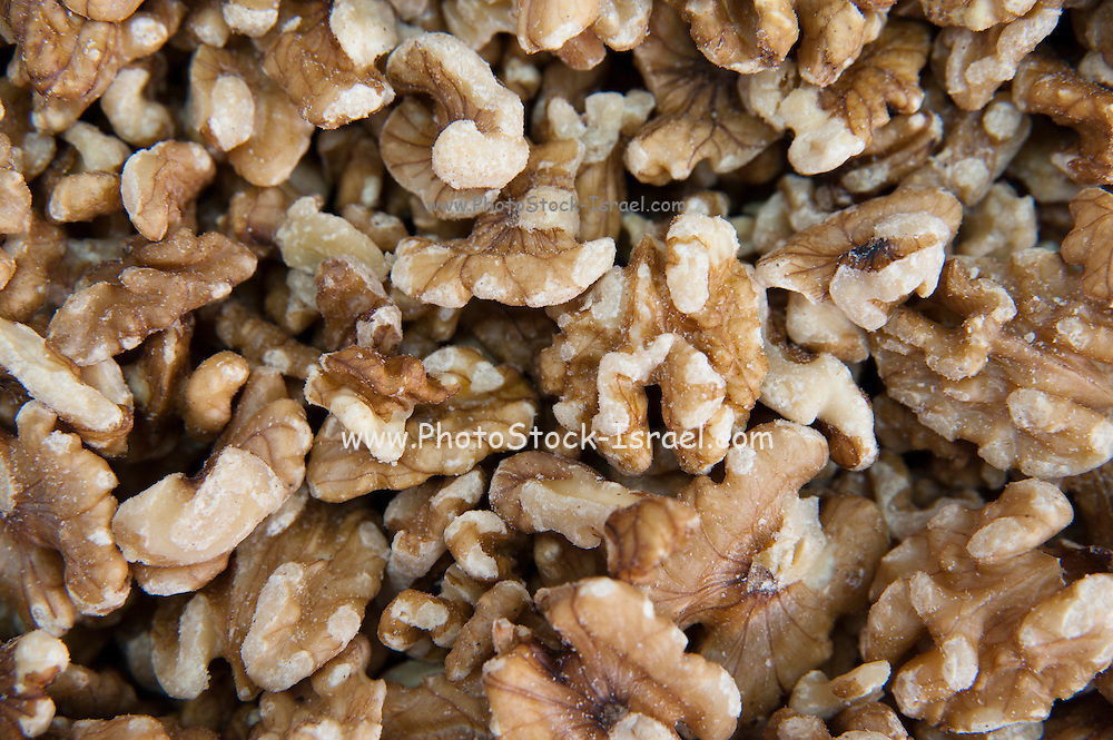 A pile of freshly roasted shelled walnuts