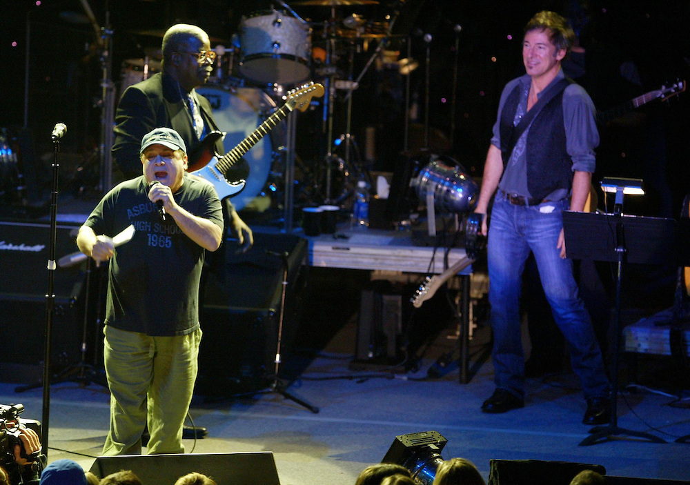(PMONMOUTH) Asbury Park 12/5/2003  Former Asbury Park graduate Danny DeVito gets the crowd intot he night as Bruce stands behind.    Michael J. Treola Staff Photographer......MJT