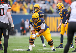 Nov 23, 2019; Morgantown, WV, USA; West Virginia Mountaineers offensive lineman Michael Brown (57) pauses before a snap during the fourth quarter against the Oklahoma State Cowboys at Mountaineer Field at Milan Puskar Stadium. Mandatory Credit: Ben Queen-USA TODAY Sports