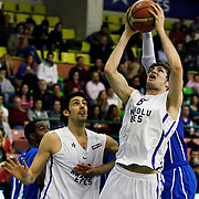 Anadolu Efes's Birkan Batuk (L) during their Turkish Basketball League match Anadolu Efes between Antalya BSB at the Ayhan Sahenk Erdem Arena in Istanbul, Turkey, Sunday, February 24, 2013. Photo by Aykut AKICI/TURKPIX
