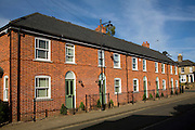 Modern red brick terraced housing in traditional style, St John's Street, Woodbridge, Suffolk, England