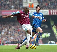 Photo: Ed Godden.<br />West Ham United v Chelsea. The Barclays Premiership.<br />02/01/2006. <br />West Ham's Marlon Harewood (L) strides past Asier Del Horno.