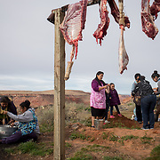 As each sheep was butchered, a group of women cleaned the intestines so they could be cooked and served the next day.