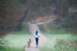 © Licensed to London News Pictures. 10/01/2019. Sidcup, UK. A frosty run for this lady with her dog at Footscray Meadows,Sidcup. Freezing cold weather this morning in South East London. Photo credit: Grant Falvey/LNP
