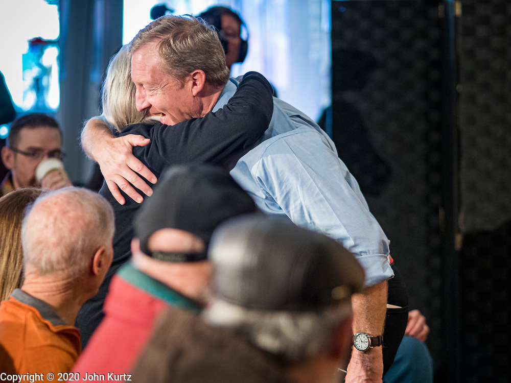 29 JANUARY 2020 - KNOXVILLE, IOWA: TOM STEYER hugs a woman at a campaign event in Knoxville, about 40 miles southeast of Des Moines, Wednesday. About 60 people attended the campaign meet and greet. Steyer, a California businessman, is campaigning to be the Democratic nominee for the US Presidency in 2020. Iowa holds the first selection event of the 2020 election cycle. The Iowa Caucuses are Feb. 3, 2020.         PHOTO BY JACK KURTZ