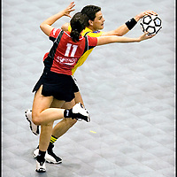 The Netherlands, Rotterdam, 06-05-2006.<br /> Korfball, The Final of the dutch national championships.<br /> Dalto vs DOS '46   <br /> Annemiek Verra ( number 11 ) player of DOS '46 is attacked by Riko Kruit player of Dalto and that's not allowed because men and women play side-by-side, but duels are man to man and woman to woman.<br /> Photo: Klaas Jan van der Weij