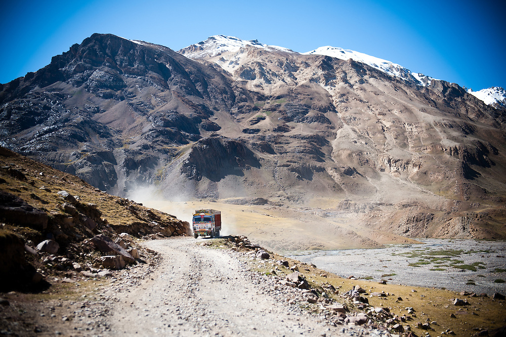 A truck on a desert road in Spiti Valley, India