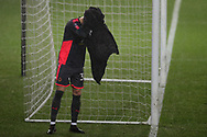 Will Norris, the goalkeeper of Wolverhampton Wanderers covers his head with a towel. The Emirates FA Cup, 3rd round replay match, Swansea city v Wolverhampton Wanderers at the Liberty Stadium in Swansea, South Wales on Wednesday 17th January 2018.<br /> pic by  Andrew Orchard, Andrew Orchard sports photography.