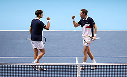 Pierre Hugues Herbert (left) and Nicolas Mahut celebrate taking a point against Juan Sebastian Cabal and Robert Farah in the Mens Doubles semi final during day seven of the Nitto ATP Finals at The O2 Arena, London.