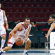 Galatasaray Cafe Crown's Evren BUKER (C), Ermal KURTOGLU (L) and Asefa Estudiantes's Sergio SANCHEZ (R) during their ULEB Eurocup Quarterfinals last 16 group K game 2 basketball match Galatasaray between Asefa Estudiantes at the Abdi Ipekci Arena in Istanbul at Turkey on Tuesday, January, 25, 2011. Photo by TURKPIX
