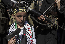October 2, 2016 - Gaza City, The Gaza Strip, Palestine - A Palestinian boy carry toy gun during Islamic Jihad Movement military rally marking the first anniversary of the Al-Quds uprising in Gaza city. (Credit Image: © Mahmoud Issa/Quds Net News via ZUMA Wire)