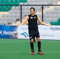 NEW DELHI - Simon Child van Engeland tijdens de derde poulewedstrijd in de finaleronde van de Hockey World League tussen de mannen van Nieuw-Zeeland en Engeland.  ANP KOEN SUYK