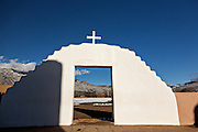 San Geronimo Church gate at the ancient Native American Taos Pueblo outside Taos, New Mexico. The pueblos are considered to be one of the oldest continuously inhabited communities in the United States and is designated a UNESCO World Heritage Site.