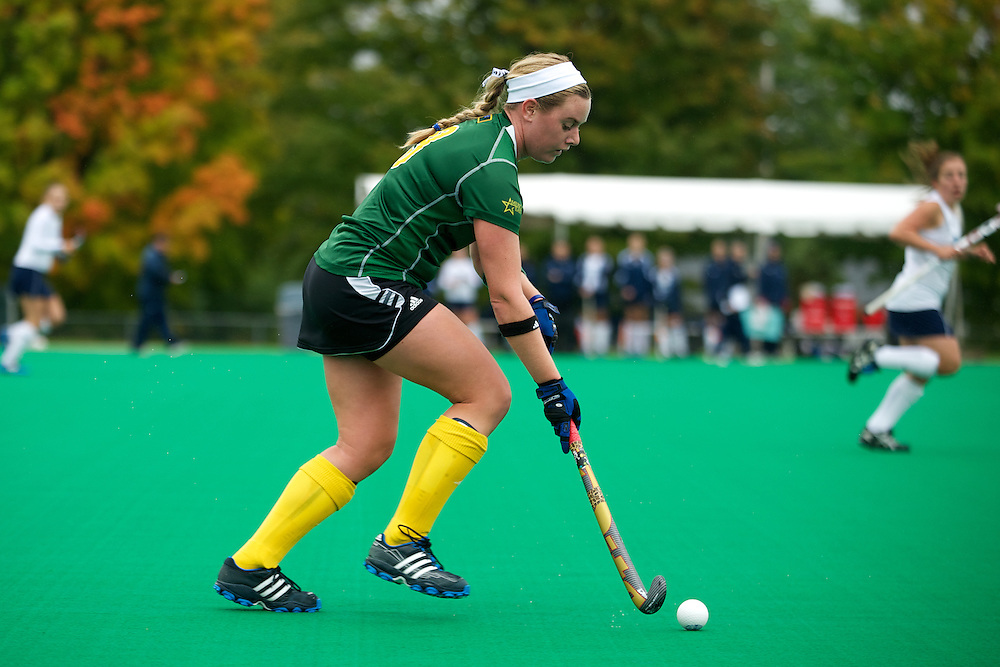 Catamounts midfielder Callie Bellimer (11) runs with the ball down the field during the women's field hockey game between the Maine Black Bears and the Vermont Catamounts at Moulton/Winder Field on Saturday afternoon September 29, 2012 in Burlington, Vermont.
