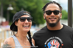 Jody Perewitz with NE Patriot safety Patrick Chung after she finished MC'ing the annual bikini contest at the Naswa resort during Laconia Motorcycle Week. NH, USA. Thursday, June 14, 2018. Photography ©2018 Michael Lichter.