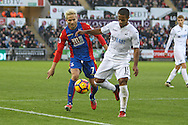 Wayne Routledge of Swansea City and Yohan Cabaye of Crystal Palace during the Premier League match between Swansea City and Crystal Palace at the Liberty Stadium, Swansea, Wales on 26 November 2016. Photo by Andrew Lewis.