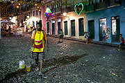 Middle aged Brazilian male man making bubbles in the historic centre of Salvador da Bahia, Pelourinho, Bahia, Brazil.