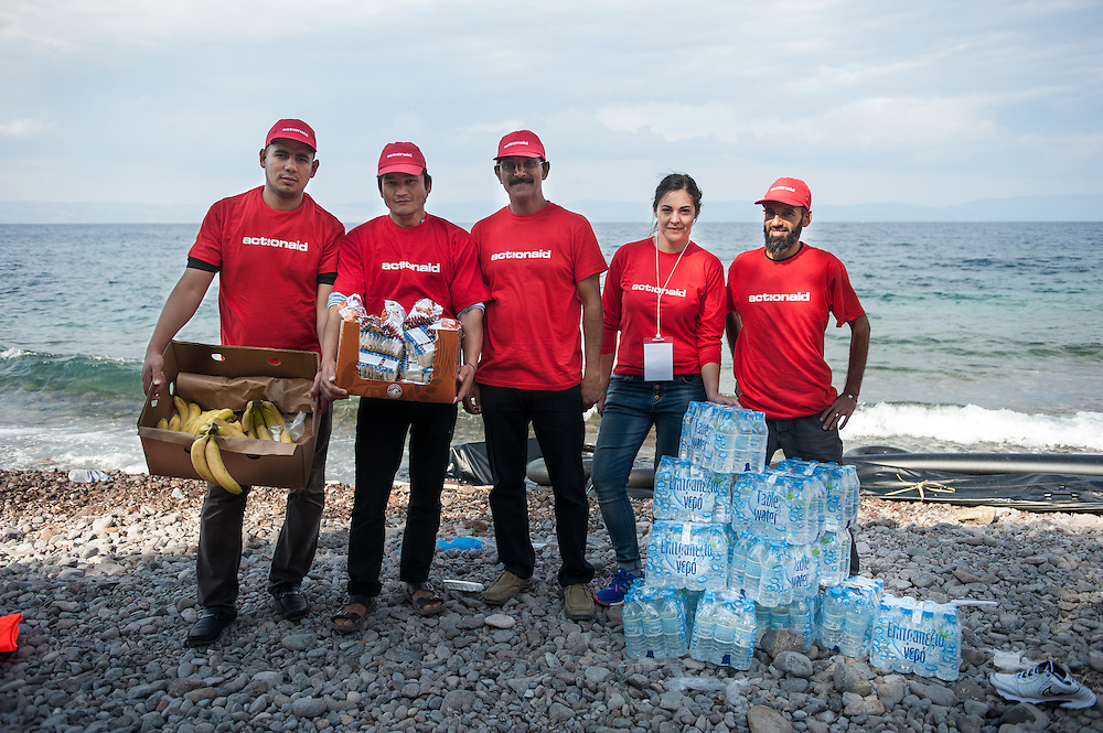 ActionAid's team in Lesvos Moustafa, Abbas, Amar,  Constantina  and Hamid infront of food and clothes given to newly arrived refugees and migrants. Skala Sykamias, Lesvos, Greece