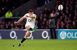 England's Owen Farrell kicks at goal but misses during the Autumn International match at Twickenham Stadium, London.