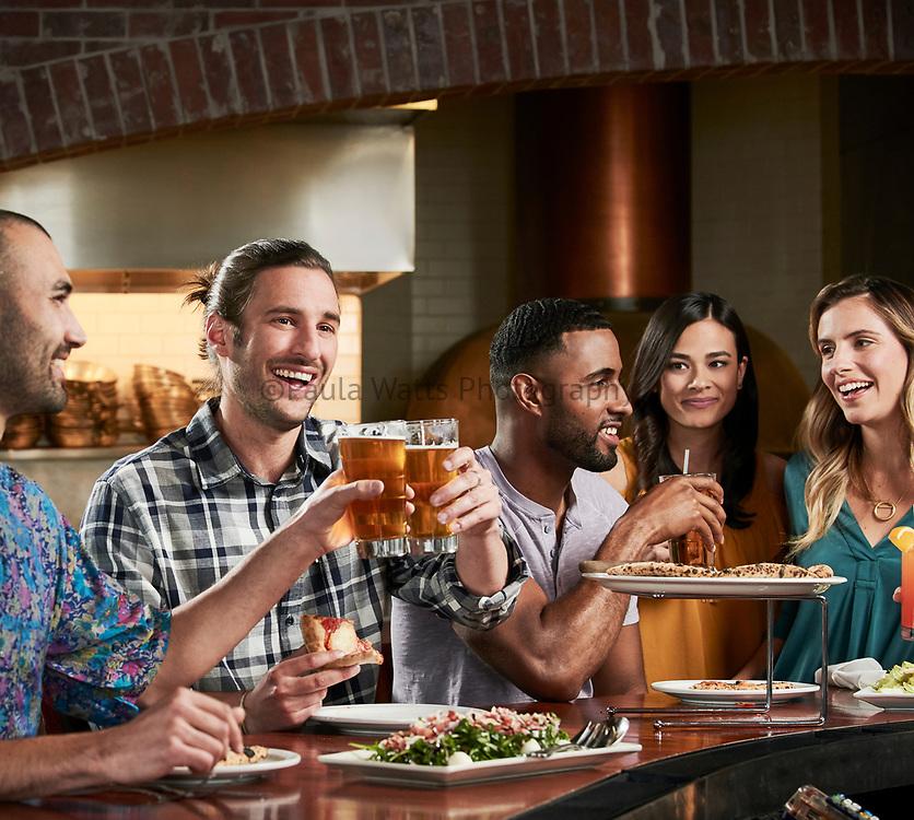 Friends enjoying restaurant bar in California