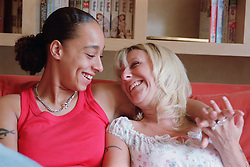Portrait of lesbian couple laughing,