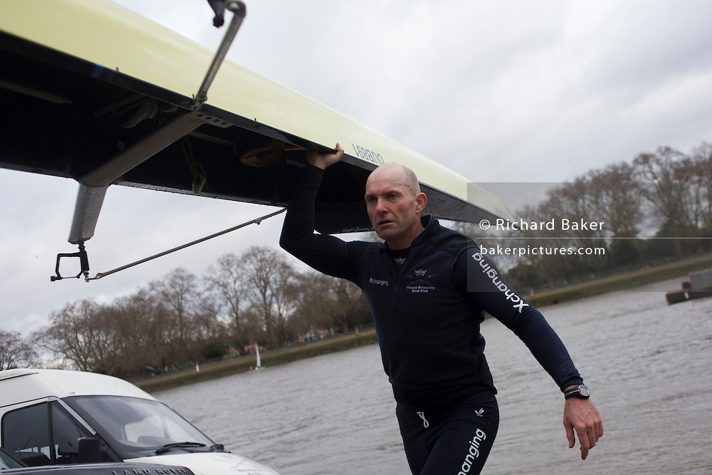 The Australian born Oxford University veteran rower James Ditzell carries his boat after a training row on the Thames. Many of his team mates are only 19. At 45 James is currently the oldest ever rower in the history of the boat race. He trains with the rest of his squad on the Thames from Putney in West London under race conditions, hoping that as race day (April 6th 2012), his times are good enough for a seat in one of two of Oxford boats. First raced in 1829 the boat race between Oxford and Cambridge unbiversities is one of the oldest sporting events in the world. It is nowadays watched by thousands along the banks of The Thames Tideway, between Putney and Mortlake in London and by millions more on TV around the world.