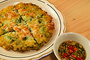 Brooklyn, NY - 26 April 2014. A seafood pajun (sometimes spelled pajeon), a Korean scallion and chive pancake, with seafood, at Dotory.