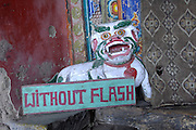 India - Tuesday, Nov 28 2006: A sign requesting that photographers refrain from using flash inside the Hemis Gompa monastery in Ladakh. At an altitude of 12,000 ft, the monastery is one of the highest settlements in the world. (Photo by Peter Horrell / http://www.peterhorrell.com)
