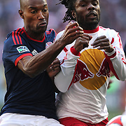 Pegguy Luyindula, (right), New York Red Bulls, is challenged by Jose Goncalves, New England Revolution, during the New York Red Bulls Vs New England Revolution, MLS Eastern Conference Final, first leg at Red Bull Arena, Harrison, New Jersey. USA. 23rd November 2014. Photo Tim Clayton