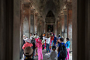 Tourist and visitors explore within Angkor Wat Siem Reap, Cambodia. Angkor Wat is Cambodia's main tourist destination and one of UNESCO's world heritage sites.