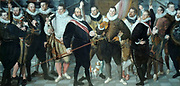 The Company of Captain Dirck Jacobsz Rosecrans and Lieutenant Pauw by Cornells Ketel (1548-1616) oil on canvas, 1588.  Thirteen self-assured officers of the Amsterdam militia, the city's armed civic guard, are portrayed here.  From 1580, at the initiative of William of Orange, the old militia guilds were refashioned into civic guards organized along military lines.  The officers were recruited from the upper levels of society.  The dark muzzled dog at right contrasts comically with the jaunty little lapdog at centre jumping up on its owner's legs.