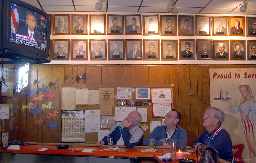 Veterans Joe Hayden, left, Bill Perkins and Frank Thompson watch as President George W. Bush announces the war with Iraq Wednesday, March 19, 2003, at the Robert E. Newman VFW Post 3636 in Louisville, Ky. (AP Photo/Brian Bohannon)