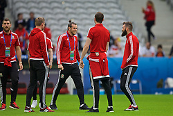 LILLE, FRANCE - Friday, July 1, 2016: Wales Gareth Bale and Joe Ledley share a joke on the pitch ahead of the pre-match warm-up before the UEFA Euro 2016 Championship Quarter-Final match against Belgium at the Stade Pierre Mauroy. (Pic by Paul Greenwood/Propaganda)