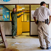 Billy Padovich, left, and Franklin Boyd of the Gallup Police coordinate a police training exercise at the old Juan de Oñate Elementary School in Gallup Friday.