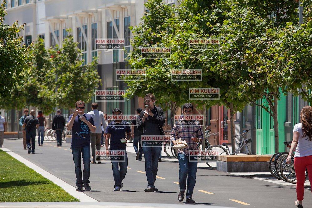 """Scenes of daily work and life at Facebook', Inc. USA Headquarters in Menlo Park, California.  Facebook employees and visitors walk through """"Hacker Square."""""""