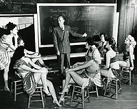 1945 Earl Carroll planning the show with his showgirls