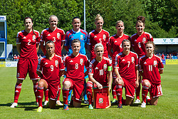 HAVERFORDWEST, WALES - Saturday, June 14, 2014: Wales players line up for a team group photograph before the FIFA Women's World Cup Canada 2015 Qualifying Group 6 match against Turkey at the Bridge Meadow Stadium. Back row L-R: Nicola Cousins, Helen Bleazard, Nicola Davies, Sophie Ingle, Kylie Davies, Angharad James. Front row L-R: Natasha Harding, Hayley Ladd, captain Jessica Fishlock, Loren Dykes, Sarah Wiltshire. (Pic by David Rawcliffe/Propaganda)