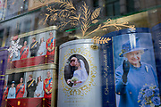 British royal family merchanidise and tourism souvenir tea bags which show the Windsors on the balcomy of Buckingham Palace, and of Meghan Markle and Prince Harry, the Duke and Duchess of Sussex at their 2018 wedding, behind two exclamation marks,  and Queen Elizabeth, in the window of trinket shop in the West End, on 15th January 2020, in London, England.