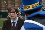 Anti Brexit, protester debates with Leave supporters in Westminster as the leader of the opposition and the Prime Minister continue talks to solve the Brexit Withdrawal Agreement on 13th April 2019 in London, England, United Kingdom. With just over two weeks until the UK is supposed to be leaving the European Union, the final result still hangs in the balance.