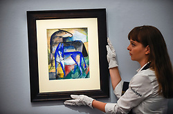 © Licensed to London News Pictures. 29/01/2020. LONDON, UK. A staff member presents ''Zwei Blaue Esel (Pferd Und Esel) (Two Blue Donkeys - Horse And Donkey)'' by Franz Marc, (Est. £1,000,000 - 1,500,000).  Preview of Sotheby's Impressionist & Modern and Surrealist Art sales.  The auction will take place at Sotheby's New Bond Street on 4 and 5 February 2020.  Photo credit: Stephen Chung/LNP