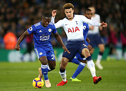 Leicester City's Nampalys Mendy (left) and Tottenham Hotspur's Dele Alli battle for the ball during the Premier League match at the King Power Stadium, Leicester.